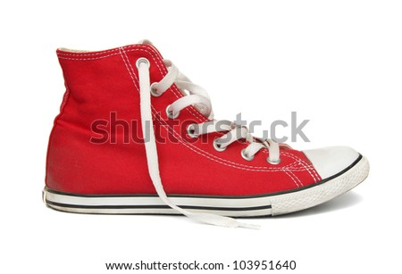 Red gym shoes isolated on a white background. - stock photo