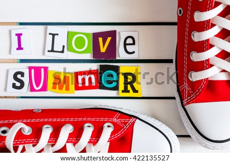 Red Gymshoes and I Love summer - written with color magazine letter clippings on wooden board. Summer vacation concept