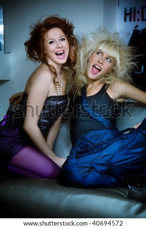 red hair and blond happy girls on a home party, indoor shot - stock photo