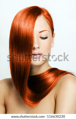 red hair , beautiful young red-headed woman with long shiny hair , hairstyle - stock photo