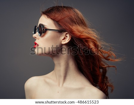 Red Hair. Fashion Girl Portrait. glasses