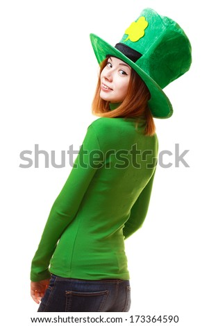 Red hair girl in Saint Patrick's Day leprechaun party hat having fun isolated on white background