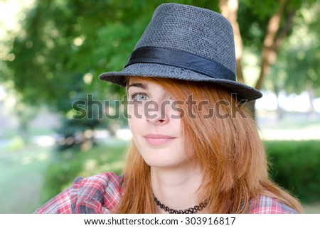 Red hair girl with fedora hat