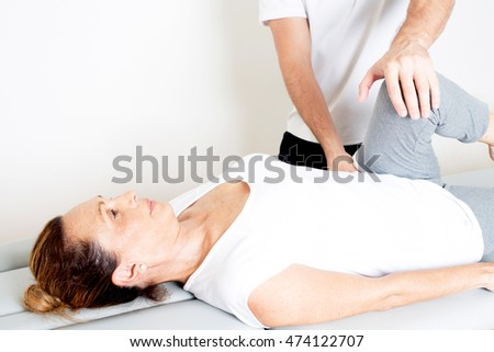 Red hair woman during a knee manipulation