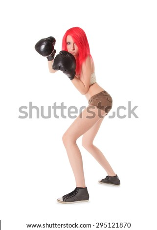 Red hair woman is boxing over white