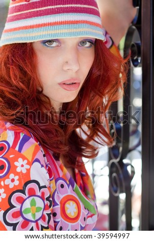 red hair woman portrait in colorful clothes, outdoor shot - stock photo