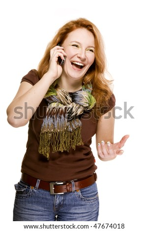 red-haired adult woman on white background emotionally speaking the mobile cell phone - stock photo
