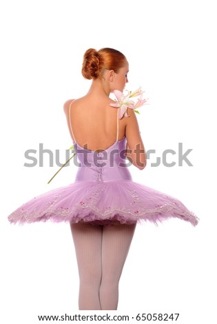 red-haired ballet dancer to take a sniff of lily - stock photo