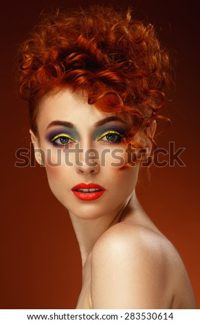 Red-haired. Beautiful girl with bright makeup. Ginger. Hairstyle.