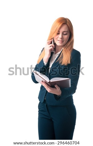 Red-haired businesswoman with a diary in hands