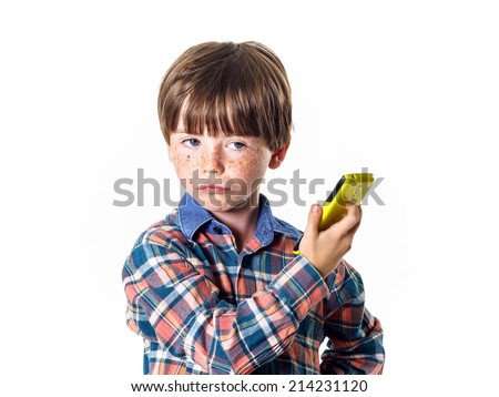 Red-haired funny boy with yellow mobile phone, preschooler - stock photo