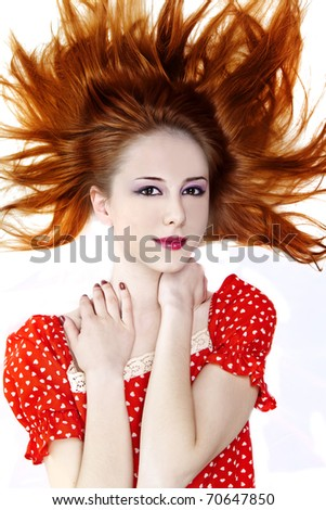 Red-haired girl in dress. Studio shot. - stock photo