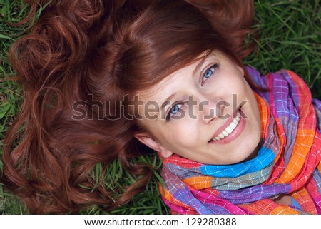 red-haired girl on a walk in autumn - stock photo