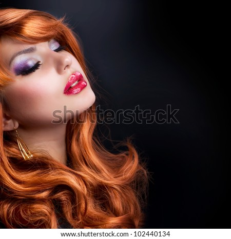 Red Haired Girl Portrait over Black - stock photo