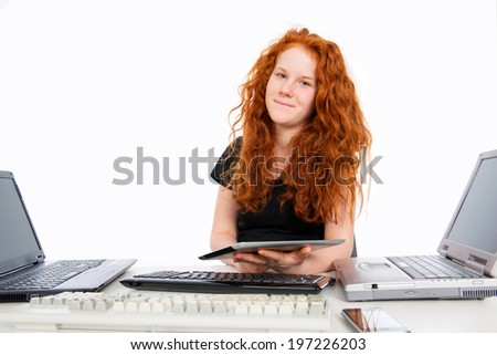 red haired girl with a lot of computer