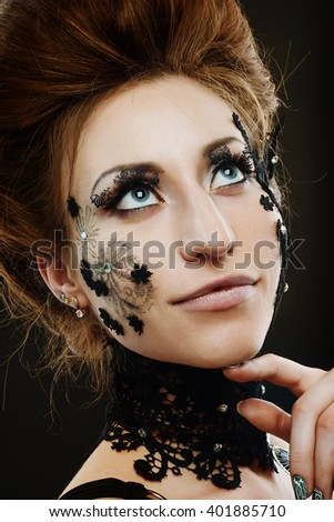 red-haired girl with dark make-up. flowers from lace