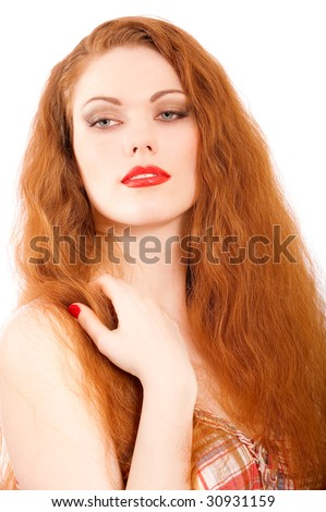 Red-haired girl with dismissed hair and red manicure.