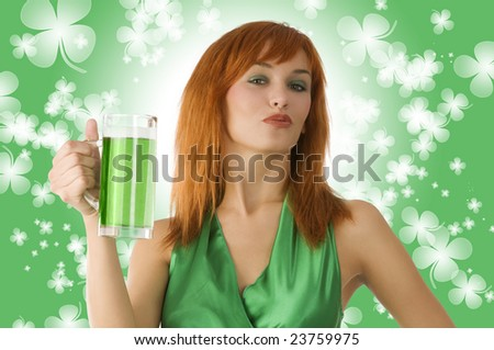 red haired Irish lass posing in green dress and drinking green beer