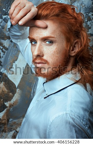 Red-haired man with a beard and mustache in a white shirt metrosexual. - stock photo