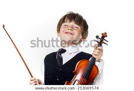 Red-haired preschooler boy with violin, music education - stock photo