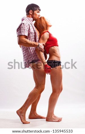 Red-haired woman and man on a white background in studio