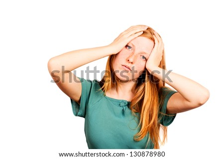 Red-haired woman expressing fatigue and headache
