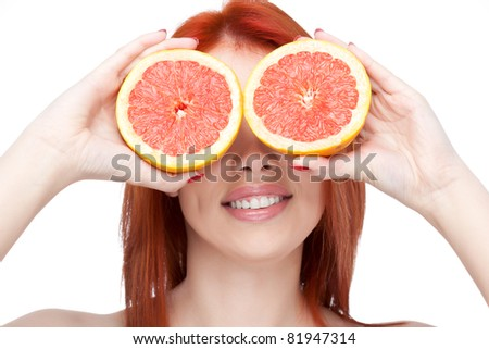 red-haired woman holding grapefruit over white