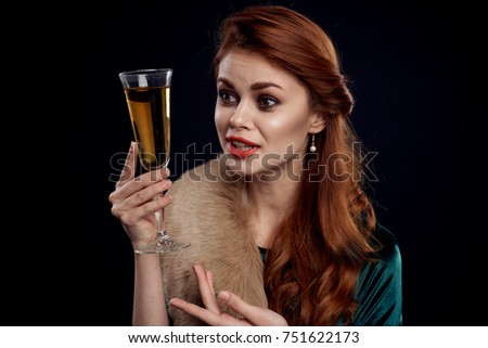 red-haired woman with a glass in hands, new year