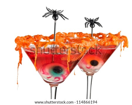 Red halloween cocktails with eyes and spiders - stock photo