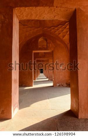 Red Hallway at the Taj Mahal - stock photo