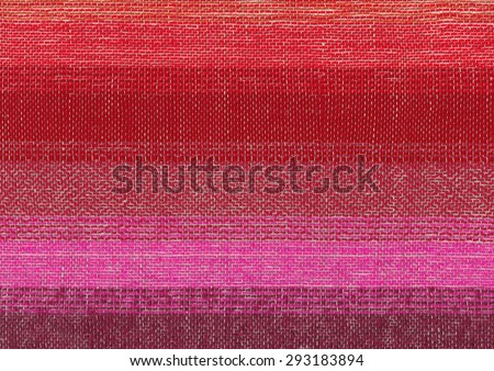 Red hand-woven fabric - stock photo