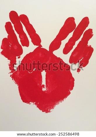 Red handprint heart  - stock photo