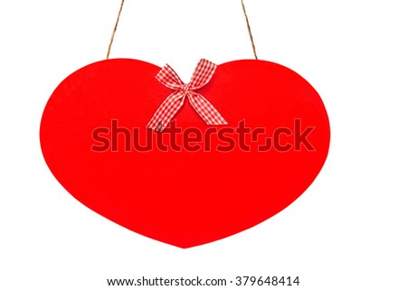 Red hanging heart with bow - stock photo