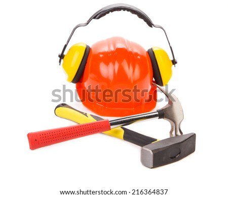 Red hard hat with gloves and instruments. Isolated on a white background.