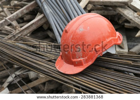 red hardhat on construction site
