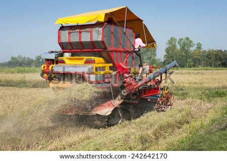 Red harvester in work, Thailand. - stock photo
