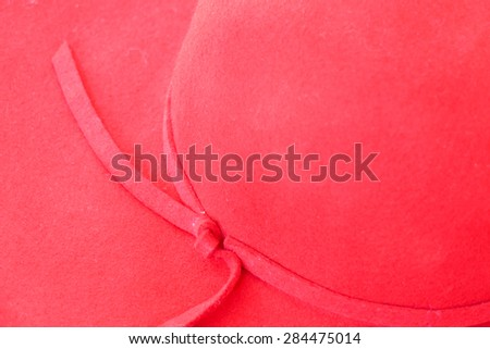 red hat on red mat for holiday and vacation concept