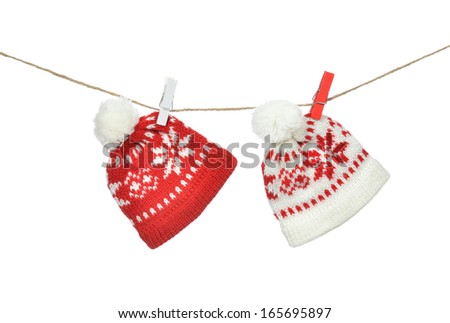 Red hats christmas patchwork ornament clipped on the rope isolated on white background