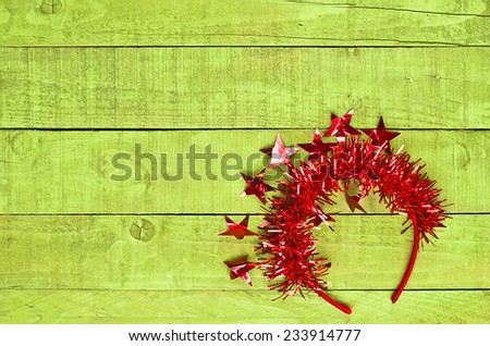 Red head band on green wooden background