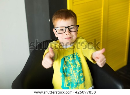 Red head boy with freckles looking shocked and surprised while smiling and holding hands in air - stock photo