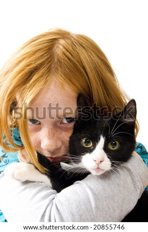 red head girl holding a black white kitten - stock photo