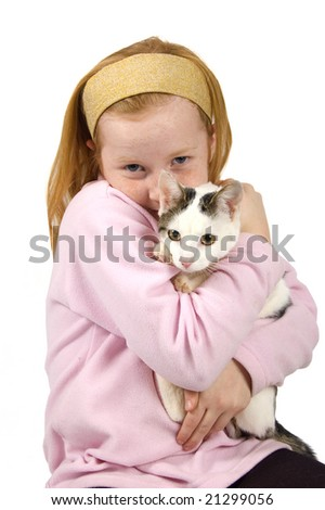 red head girl holding a white cat on white