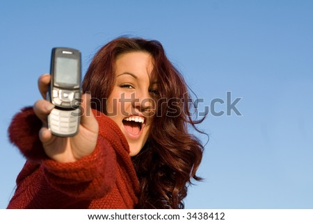 red head with cell phone - stock photo