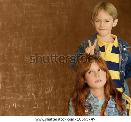 red headed girl and blond boy - stock photo