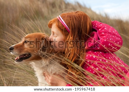 red headed girl with her red haired dog  - stock photo