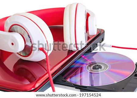 Red headphones and laptop with compact disk language course learning - stock photo