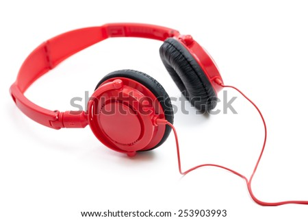 Red headphones isolated on a white background