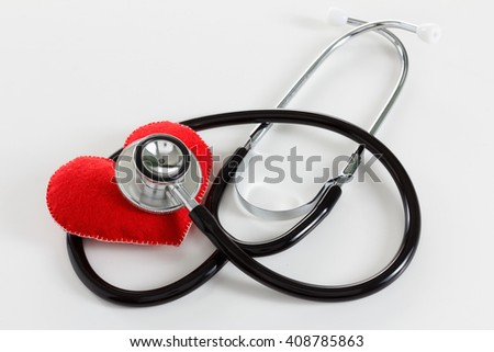 Red heart and a stethoscope. Health care, Medicine concept studio shot. On white background.