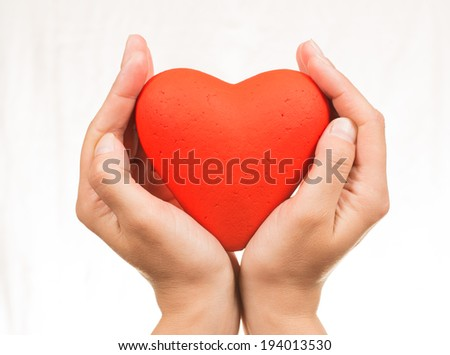 Red heart at the hands