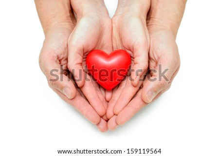 Red heart at the human hands isolated on white - stock photo